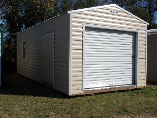 The 8 foot x 80 inch roll-up door on this metal building means that you can store your largest equipment or even small vehicles. The side walls of this unit are 8 feet tall.